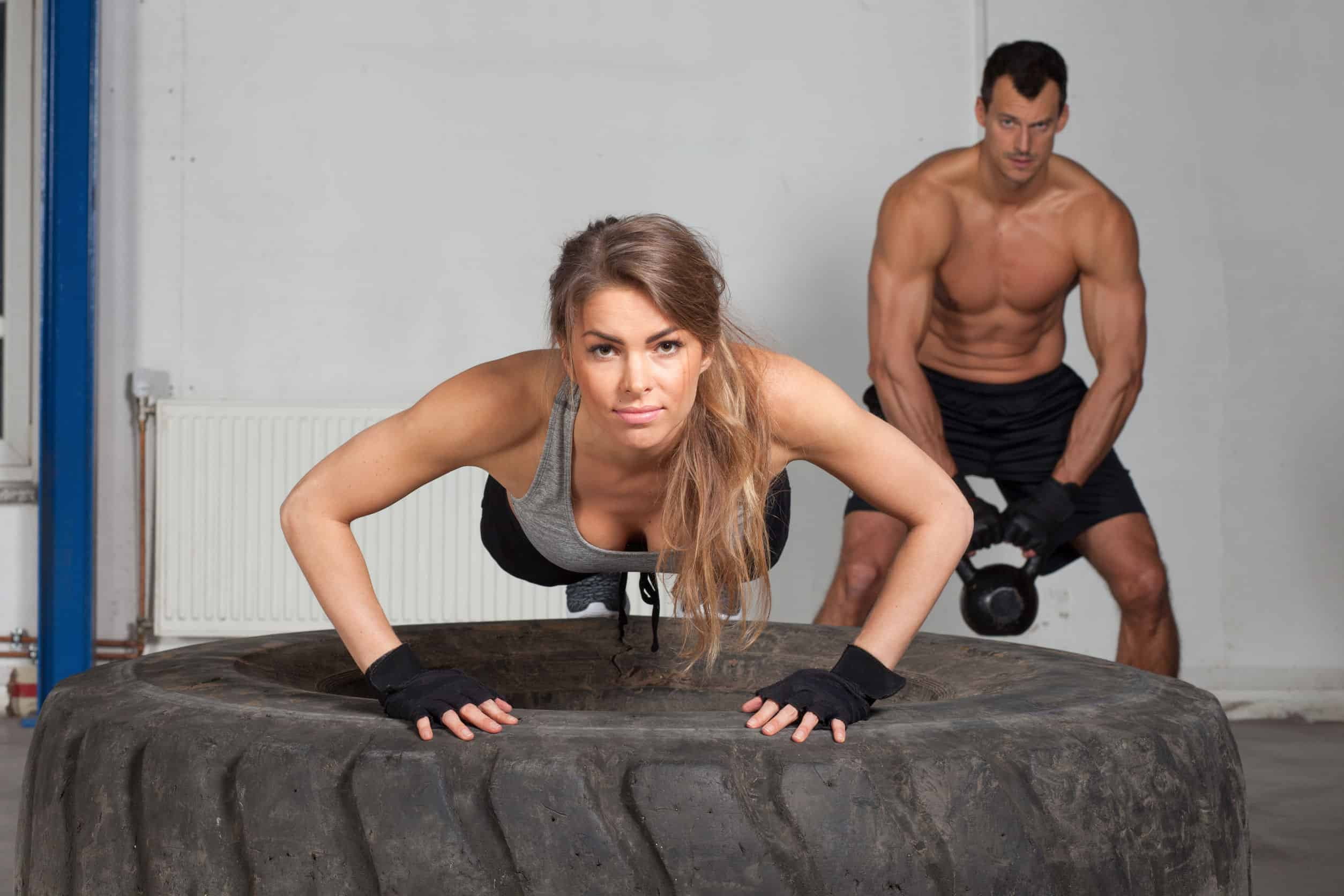 37462125 - push up on a tire crossfit training