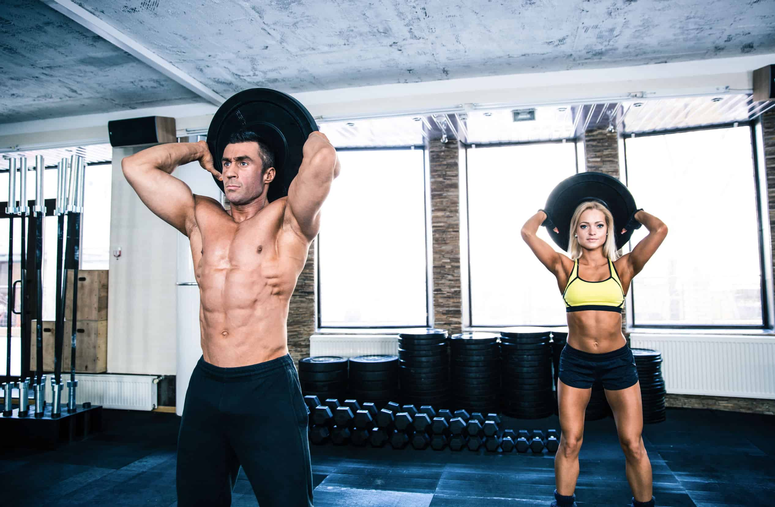 38794392 - muscular man and fit woman workout at crossfit gym