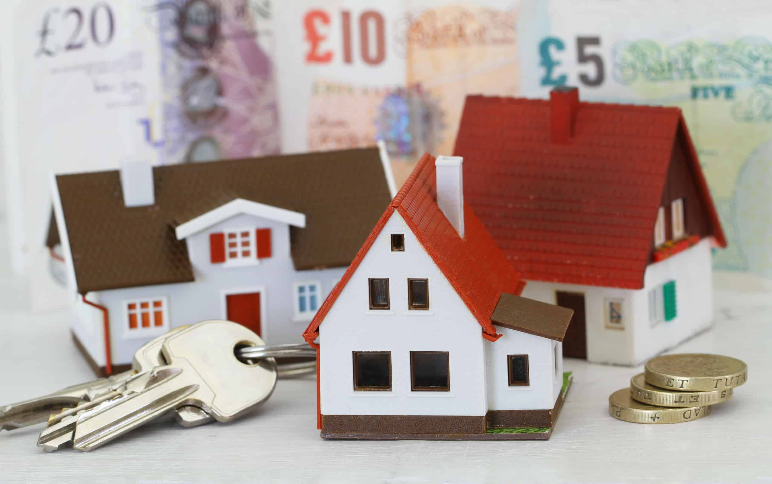 45229622 - model houses and keys with british pounds in the background