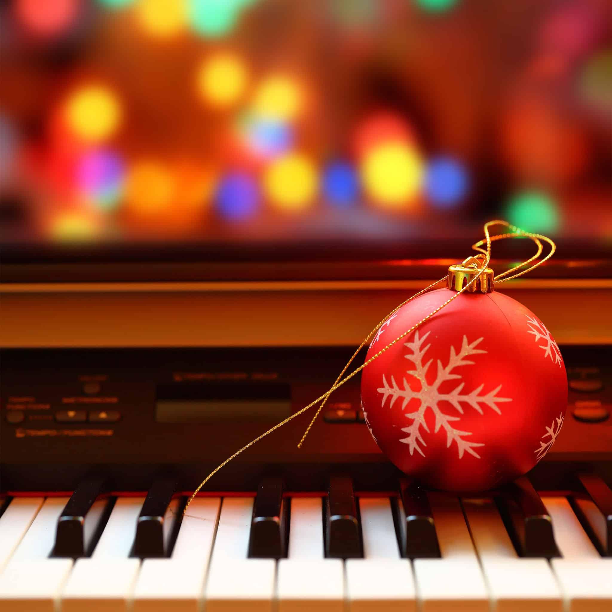 33267778 - christmas ball on piano keys
